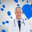 Stock Photo: Doctor standing against digitally generated background