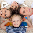 Smiling young family in front of house illustration - Stock Photo