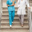 Health specialists going down the stairs — Stock Photo