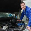 Happy mechanic repairing  car engine — Stock Photo