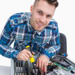 Portrait of computer engineer repairing cpu — Stock Photo