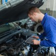 Car mechanic using tablet computer - 