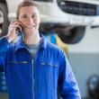 Smiling male mechanic on call — Stock Photo