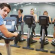Male instructor at spinning class — Stock Photo