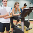 Instructor at spinning class with two women — Stock Photo