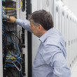 Technician working on a case of server racks - Stock Photo