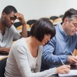 Stock Photo: Students taking lecture notes