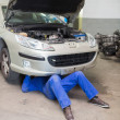 Man repairing car in garage — Stock Photo