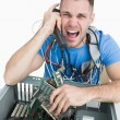 Frustrated computer engineer screaming over phone in front o — Stock Photo #24094573