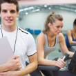 Spinning class instructor holding clipboard — Stock Photo