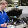 Stock Photo: Mechanic with digital tablet at garage