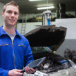 Stock Photo: Male mechanic with digital tablet at garage