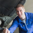 Auto mechanic working on motor — Stock Photo #24094845