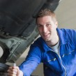 Auto mechanic working on motor — Stock Photo