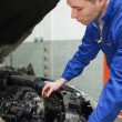 Stock Photo: Mechanic checking car engine oil