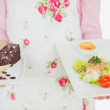 Stock Photo: Maid holding plates of healthy meal and pastry
