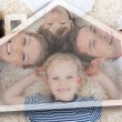 Happy young family  with house illustration - Lizenzfreies Foto