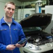 Auto mechanic holding tablet computer — Stock Photo #24095051