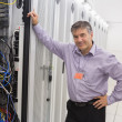 Technician leaning against server — Stock Photo