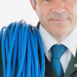 Repairman with rolled cable — Stock Photo #24095095