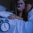 Unquiet woman in the bed at night — Stock Photo