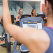 Motivational female instructor teaches spinning class — Stock Photo