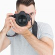Portrait of male photographer with photographic camera — Stock Photo #24095329