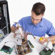 Young computer engineer working on cpu parts — Stock Photo #24095413