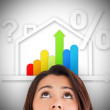 Foto Stock: Woman looking up at energy efficient house graphic