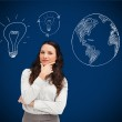 Businesswoman standing against a picture of bulbs and globe — Stock Photo