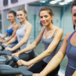 Smiling women at spinning class - Stok fotoraf