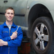 Male mechanic standing by car — Stock Photo #24096003