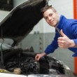 Mechanic gesturing thumbs up - Stock Photo