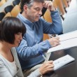 Man and woman taking notes during lecture — Stock Photo #24096247