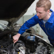Car mechanic working on engine — Stock Photo #24096279