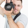 Portrait of male photographer with photographic camera — Stock Photo #24096377