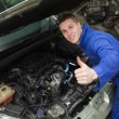 Car mechanic gesturing thumbs up — Foto Stock