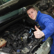 Car mechanic gesturing thumbs up — Stock Photo #24096433