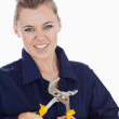 Female mechanic clenching teeth while holding pliers wrench — Stock Photo