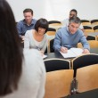 Stock Photo: Taking notes in lecture