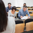 Taking notes in a lecture — Stock Photo #24096505