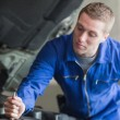 Auto mechanic working on car — Stock Photo #24096559