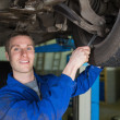 Mechanic repairing car with spanner — Stock Photo