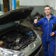 Car mechanic gesturing thumbs up — Stock Photo #24096709