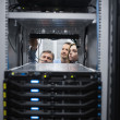 Technicians looking into servers — Stock Photo