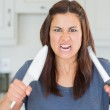 Angry woman holding up knives — Stock Photo