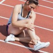 Stock Photo: Female runner with ankle injury