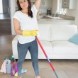 Woman with mop wiping her brow — Stock Photo