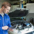 Auto mechanic working on tablet pc — Stock Photo #24097235