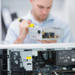 Computer engineer working on cpu part in front of open cpu — Stock Photo #24097243